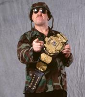 frowning helmet pointing promotional_image sgt._slaughter sunglasses wwf wwf_championship // 642x722 // 92.0KB