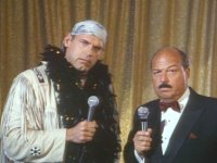 "Jesse_""The_Body""_Ventura Repossessed mean_gene_okerlund microphone raised_eyebrow suit // 424x318 // 222.3KB"