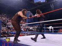 Revenge_Of_The_Taker autoplay_gif gif hugo_savinovich in_your_house mankind mick_foley steel_steps table undertaker wwf // 200x150 // 1.8MB