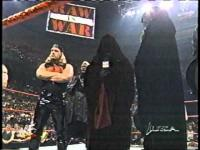 Raw The_Corporate_Ministry arms_folded hat hunter_hearst_helmsley microphone the_greater_power undertaker viscera wwf // 480x360 // 18.2KB